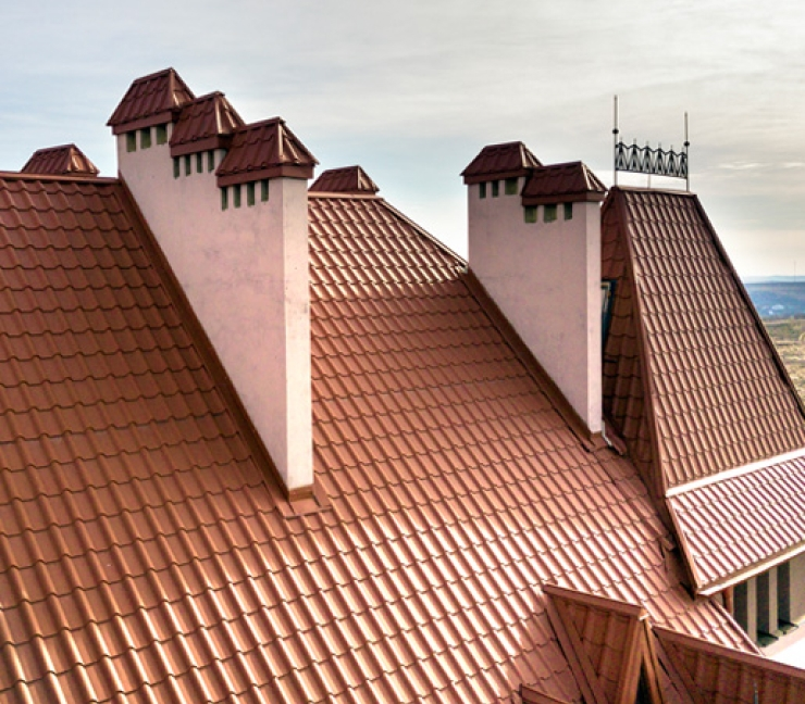 Very nice tile roof at a dramatic slant on a large expensive house.
