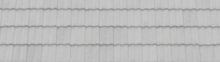 Closeup of a roof with a silicone elastomeric roof coating.