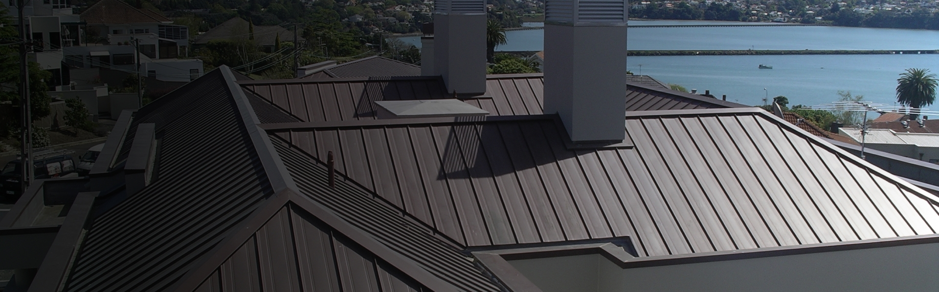 A nice metal roof with a lake in the background.