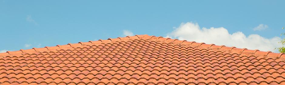 Closeup of an orange concrete tile roof.