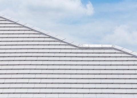 Closeup of an energy efficient flat concrete tile roof.