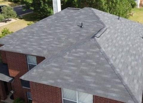 Closeup of 3 tab shingles on a roof.