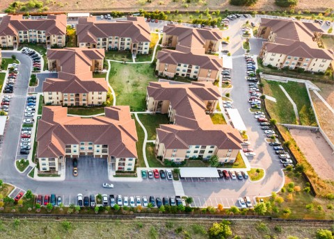 Multifamily housing with shingle roofs.