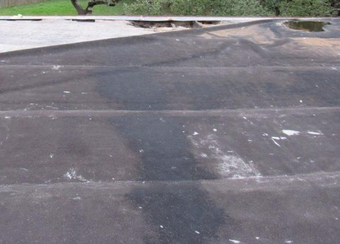 Storm damaged modified bitumen flat roof.