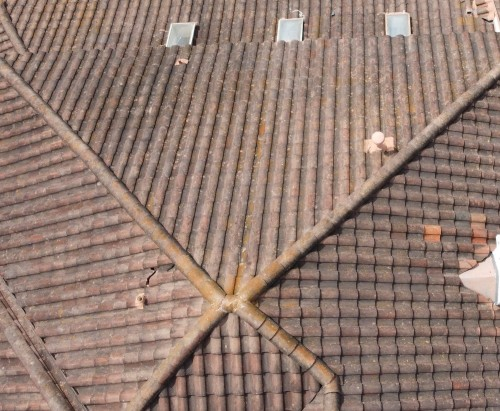 Concrete tile roof with cracked tiles from hail damage.