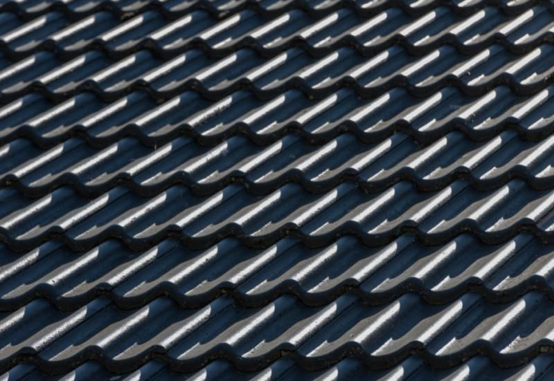Close up of a concrete tile roof.