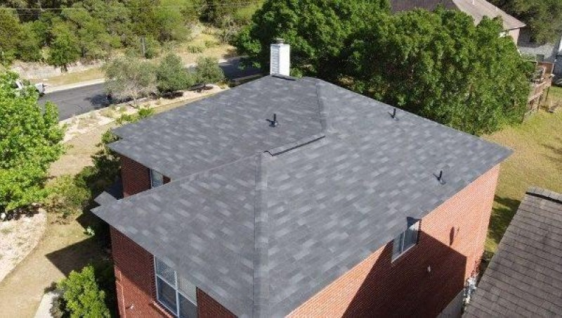 Nice 2 story house with gray 3 tab shingles.